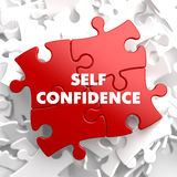 Self Confidence on Red Puzzle. Royalty Free Stock Photo