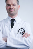 Self confident available doctor in white coat Stock Photography
