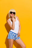 Self-confident blonde girl in a sunglasses Royalty Free Stock Photos