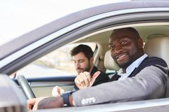 Self-confident business man as a motorist stock images