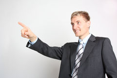 Self confident businessman. Friendly Businessman showing the direction Royalty Free Stock Image