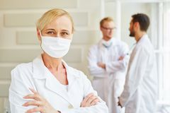 Self confident doctor. With surgical mask stock photography