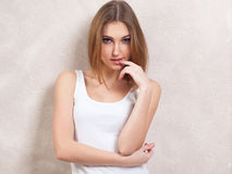 The self-confident girl in a thoughtful pose Royalty Free Stock Photography