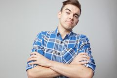Self Confident guy dressed in a plaid shirt is on a white background in the studio royalty free stock photos