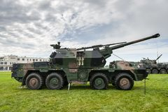 Howitzer is a powerful weapon on wheels. The self-confident howitzer is a powerful weapon on wheels stock photography