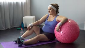 Self-confident lady delighted with successful workout, dreaming about new dress royalty free stock photos