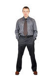 Self-confident man in a dark shirt and dark trouse Stock Photography