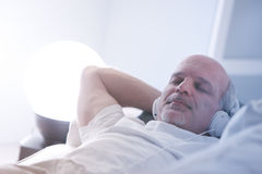 Self-confident man relaxing on a sofa royalty free stock image
