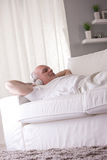 Self-confident man relaxing on a sofa Stock Photography