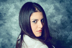 Self confident mediterranean young woman with long brown hair Stock Photography