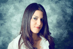 Self confident mediterranean young woman with long brown hair Royalty Free Stock Photography