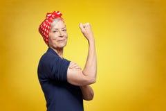 Free Self-confident Senior Woman Rosie Riveter Stock Images - 161077934