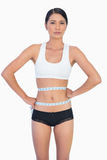 Self confident slim woman measuring her waist Royalty Free Stock Photo