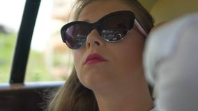 Self-confident successful businesswoman travelling by car, enjoying freedom. Stock footage stock footage