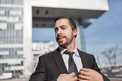 Self-confident and successful entrepreneur. Confident and successful entrepreneur or manager outdoors Stock Photos