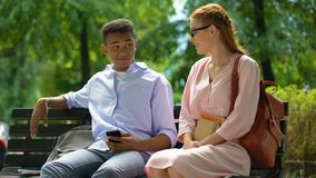 Self-confident teenager rejecting red-haired girl, first love relationship stock video footage