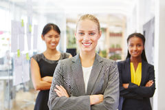 Self confident woman as consultant. Self confident women as consultant and her team Stock Photos