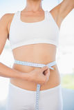 Self confident woman measuring her waist Royalty Free Stock Photo
