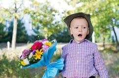 Self-conscious little boy singing Stock Image