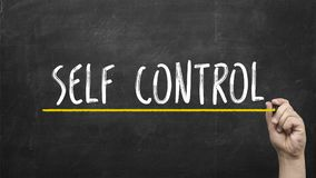 Self control concept. Hand with yellow marker writing self control inscription text on chalkboard. Royalty Free Stock Photos