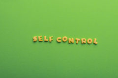 Self controt concept, words made of cookies  on green. Self controt concept,  words made of cookies  on green. healthy lifestyle and healthy living concept Stock Image