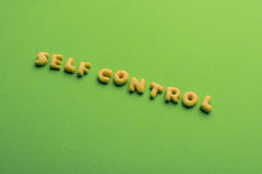 Self controt concept, words made of cookies isolated on green. Self controt concept,  words made of cookies isolated on green. healthy lifestyle and healthy Stock Photo