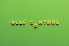 Self controt concept, words made of cookies isolated on green. Self controt concept,  words made of cookies isolated on green. healthy lifestyle and healthy Royalty Free Stock Image