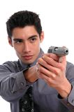 Self Defense. A young man drawing a gun in self defense Royalty Free Stock Photography