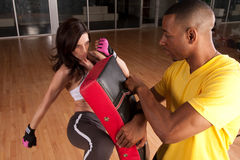 Self defense. A woman trains at kickboxing or self defense Stock Photography
