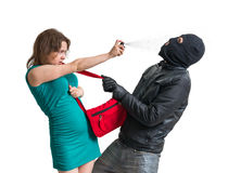 Self defense concept. Young woman is defending with pepper spray. Royalty Free Stock Images