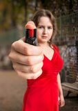 Self defense concept. Young woman holds pepper spray in hand. Stock Photography