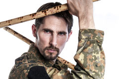 Self defense instructor with bamboo sticks Royalty Free Stock Photos