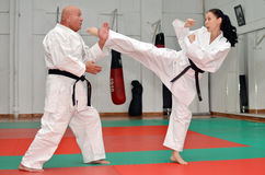 Self Defense Karate Lesson. Karate kick and self defense lessons with master and student Royalty Free Stock Images