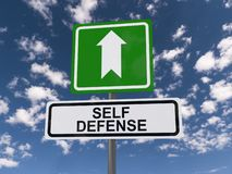 Self defense roadsign. A close up of a self defense roadsign with the sky in the background stock image