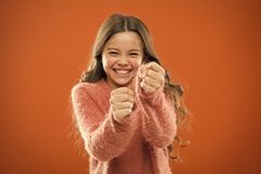 Self defense strategies kids can use against bullies. Girl hold fists ready attack or defend. Girl child cute but strong. Self defense for kids. Defend stock photos