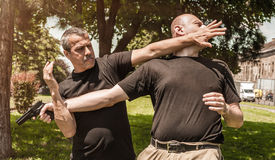 Free Self Defense Techniques Against A Gun Stock Photography - 74293262