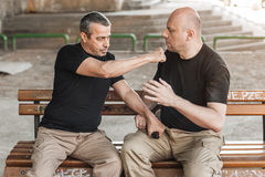 Self defense techniques against a gun Stock Image
