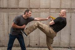 Self defense techniques against a gun. Kapap instructor demonstrates self defense techniques against a gun royalty free stock photos
