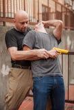 Self defense techniques against a gun. Kapap instructor demonstrates self defense techniques against a gun royalty free stock image