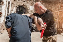 Self defense techniques against a knife attack Royalty Free Stock Photos