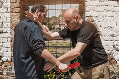 Self defense techniques against a knife attack. Kapap instructor demonstrates self defense techniques against a knife attack royalty free stock photos