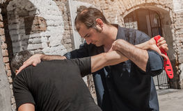 Self defense techniques against a knife attack. Kapap instructor demonstrates self defense techniques against a knife attack royalty free stock photo
