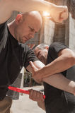 Self defense techniques against a knife attack. Kapap instructor demonstrates self defense techniques against a knife attack Stock Photography