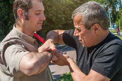 Self defense techniques against a knife attack. Kapap instructor demonstrates self defense techniques against a knife attack royalty free stock image