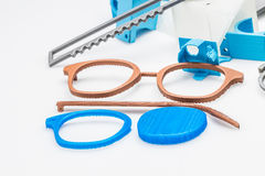 Self designed and 3D printed glasses. Blue, transparent, grey, yellow and black color  material colours. Models are printed and ready to be assembled Royalty Free Stock Images
