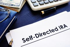 Self-Directed IRA SDIRA documents on a desk. Self-Directed IRA SDIRA documents on the desk royalty free stock photos