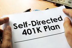 Self directed 401k plan. Self directed 401k plan written on a paper Stock Photos