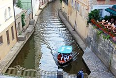 Self drive tourist boat on canal, Prague. Royalty Free Stock Image