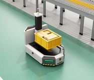 Self driving AGV with forklift carrying container box beside  conveyor. Self driving AGV Automatic guided vehicle with forklift carrying container box beside Royalty Free Stock Image