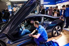 Self-driving BMW i8 Roadster and virtual reality Microsoft HoloLens by IBM company on exhibition fair Cebit 2017 in Stock Photos